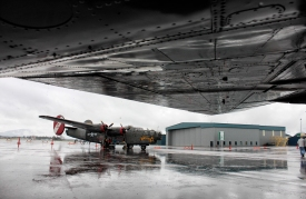 "Consolidated B-24 Liberator ""Witchcraft"" sits in the rain on the tarmack at Glacier Park International Airport on the afternoon of June 26. Justin Franz 