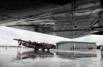 """Consolidated B-24 Liberator """"Witchcraft"""" sits in the rain on the tarmack at Glacier Park International Airport on the afternoon of June 26. Justin Franz   Flathead Beacon"""