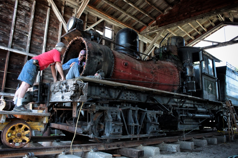 Ron Carter, left, and Jay Matthews discuss the restoration of J. Neils Lumber Co. steam locomotive number 4 on a recent Saturday morning. After being on display for nearly 50 years, the engine built in 1906 by the Lima Locomotive Works is currently being restored to operation. - Justin Franz   Flathead Beacon