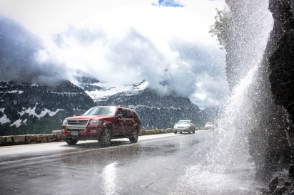 Cars pass the Weeping Wall on the Going-to-the-Sun Road, hours after the iconic road over Logan Pass was opened for the 2013 season. Justin Franz | Flathead Beacon.