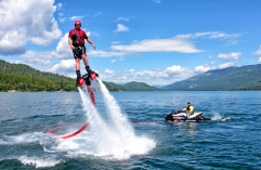 Shawn Finley, left, rides a flyboard on Whitefish Lake. The board is propelled with water from a Jet Ski. Justin Franz   Flathead Beacon.