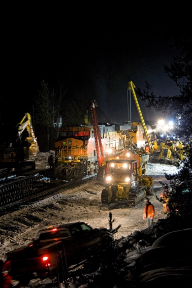 BNSF Railway employees work through the night Friday, after an eastbound freight train derailed near West Glacier early that morning. - Justin Franz | Flathead Beacon