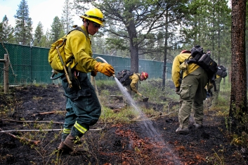 Firefighters from Smith Valley, Marion and the Department of Natural Resources and Conservation responded to a small fire near Ashley Lake on June 24. The blaze burned about a tenth of an acre, according to Smith Valley Chief D.C. Haas. Justin Franz   Flathead Beacon